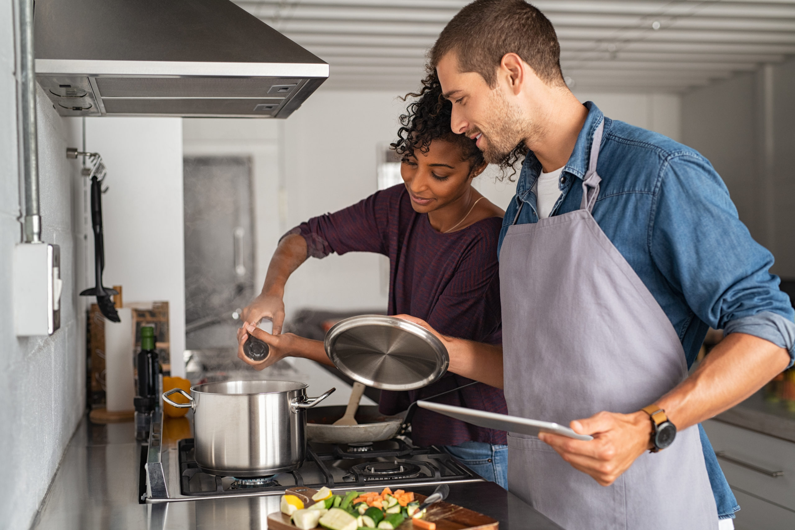 Blog - Woman adding salt in pot while cooking