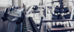 Blog - gym interior background of dumbbells on rack in fitness and workout